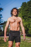 Long haired athlete getting ready for running Royalty Free Stock Images
