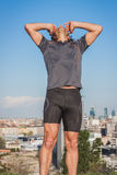 Long haired athlete stretching against blue sky Royalty Free Stock Photo