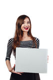 Long-haired beautiful cute brunette woman holding a rectangular blank-poster. white canvas with space for text.Red lips Royalty Free Stock Photography