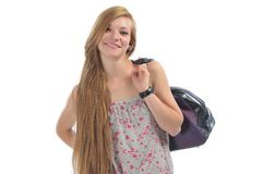 Long-haired beautiful girl with road bag Stock Images