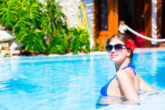 Long haired beautiful woman in luxury pool Stock Photo