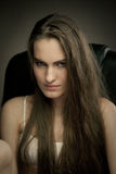 Long haired beauty with the fists Stock Photography