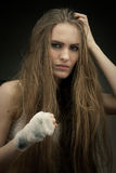 Long haired beauty with the fists Royalty Free Stock Photos