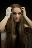 Long haired beauty with the fists Royalty Free Stock Photo