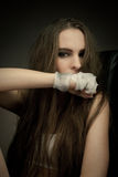 Long haired beauty with the fists Stock Image