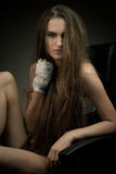 Long haired beauty with the fists Royalty Free Stock Images