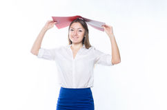 Long-haired blonde in office clothes holding an open folder above his head royalty free stock image
