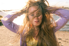 Long haired blonde outdoors wind Stock Images