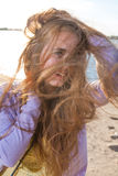 Long haired blonde outdoors wind Stock Image
