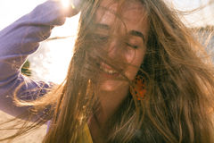 Long haired blonde outdoors wind Stock Photos