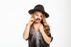 Long haired blonde posing with moustache mask on a stick. Royalty Free Stock Photo