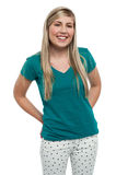 Long haired blonde teen girl in casuals Stock Photography