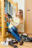 Long-haired blonde woman with shoes Royalty Free Stock Photos