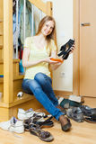 Long-haired blonde woman with shoes Royalty Free Stock Images