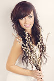 Brunette with blooming willow Royalty Free Stock Image