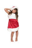 Long haired brunette little girl in Santa Claus costume royalty free stock images