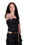 Long-haired brunette pointing a finger Royalty Free Stock Image