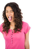 Long haired brunette sticking her tongue out Stock Image