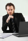 Long haired businessman sitting in a board room Royalty Free Stock Photo