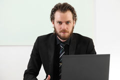 Long haired businessman sitting in a board room Stock Photos