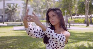 Smiling Asian woman taking selfie on smartphone with smile stock footage