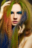 Long-haired curly redhead woman Stock Photos