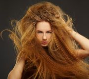 Long-haired curly redhead woman Royalty Free Stock Photos