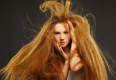 Long-haired curly redhead woman Stock Photography