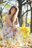 Long-haired girl  in autumn Stock Image