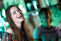 Long-haired girl in bar Royalty Free Stock Photography