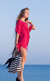 Long-haired girl on the beach Stock Photo
