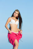 Long-haired girl on the beach Royalty Free Stock Image