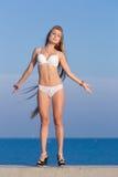 Long-haired girl on the beach Stock Photos