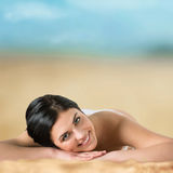 Long haired girl in bikini laying and tanning Stock Photography
