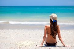 Long haired girl in bikini and straw hat on Royalty Free Stock Photography