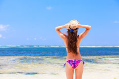 Long haired girl in bikini and straw hat on Stock Photos