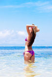 Long haired girl in bikini and straw hat on Stock Images