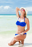 Long haired girl in bikini and straw hat on Stock Image