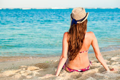 Long haired girl in bikini on tropical bali beach Royalty Free Stock Photo