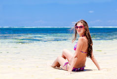 Long haired girl in bikini on tropical bali beach Stock Image