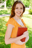 Long-haired girl with book Royalty Free Stock Images