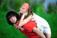 Long-haired girl and boy on green background Royalty Free Stock Photo