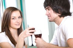 Long-haired girl and boy with wineglasses Royalty Free Stock Photos