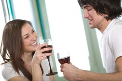 Long-haired girl and boy with wineglasses Stock Photos