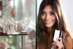 Long-haired girl with card Royalty Free Stock Photography