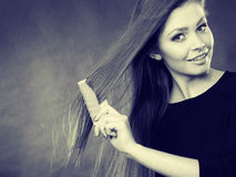Long haired girl combing her beauty hair. Stock Photo