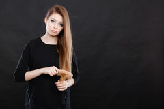 Long haired girl combing her beauty hair. Stock Image