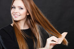 Long haired girl combing her beauty hair. Royalty Free Stock Photos