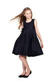 Long-haired girl in elegant black dress Stock Photography