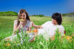 Long-haired girl with fruit and boy with smile royalty free stock photo